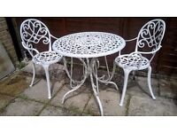 wrought iron patio table 74cm dia. and 2 chairs,cream colour .