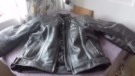 Like new Motorcycle jacket in black and grey leather. size 14.