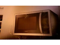 Brand New 25L capacity Stainless Steel Kenwood Microwave.