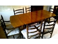 DARK WOOD DINING ROOM TABLE AND SIX CHAIRS