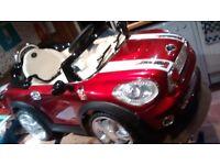 electric ride on red metallic Mini car