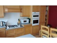 Kitchen cabinets, double oven, gas hob.