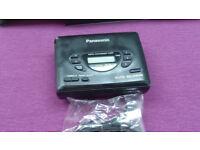 Panasonic mini stereo audio cassette player with radio and headphones.