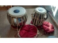 Genuine tabla drums imported from India with floor rests and covers. Used but in great condition.