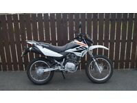 EXCELLENT CONDITION HONDA XR125L WITH FULL YEAR M.O.T AND ONLY 1400 MILES FROM NEW.
