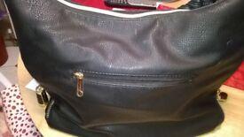 Black Leather Handbag, side zips to make it bigger.
