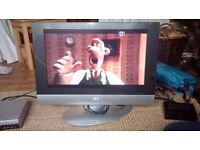 SIlver JVC television 34x57cm screen (with DVD player)