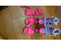 Girls pink roller boots with accessories , adjustable to 3 sizes J13, 1 & 2