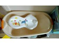 Baby bath with support seat