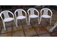 4 White plastic chairs