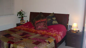 King size bed for sale. Dark wood, good quality and in good condition.
