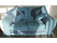 Blue fabric 2 seater sofa with extra cushions. Free to good home