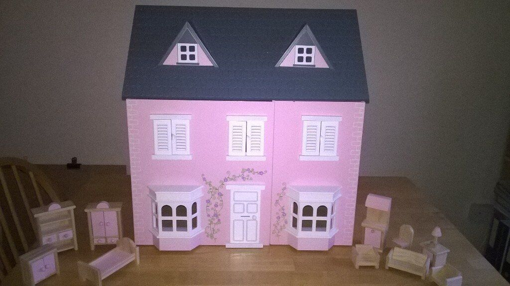 Wooden dolls house with furniture & figures, lighlty used, excellent xmas gift.