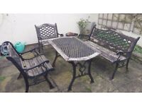 CAST IRON GARDEN SET, INCLUDES TABLE, BENCH AND 2 CHAIRS
