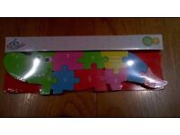 Wooden animal number puzzle. Brand new in sealed package