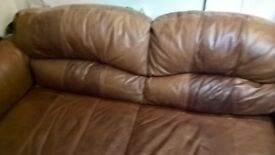 large leather sofa and buffet