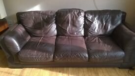 3 seater brown leather settee.