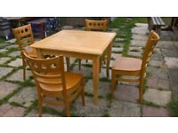 4 Solid chairs with solid table also have another one