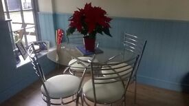 Glass top Dining table and 4 chairs chrome