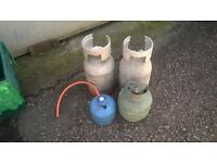 job lot of 5 various gas bottles all have gas in them