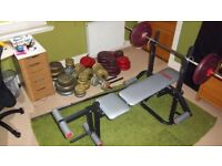 Gym bench with lots of weights