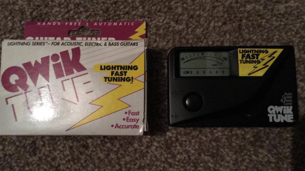 Qwik tune automatic guitar tuner qt-11 with box and instructions.