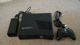 Xbox 360 4GB Black with controller and 17 Games. Excellent full working order.