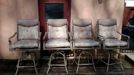 Set of four high swivel garden chairs with cushions