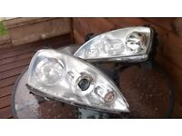 corsa headlamps. projector style halogen twin beams 2003-2006 electric adjuster