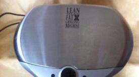 Fat grilling machine