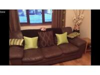 Brown leather 3 seater sofa plus foot stool.