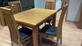 Oak dining table (extending) & 4 leather chairs in excellent condition, only 6 months old