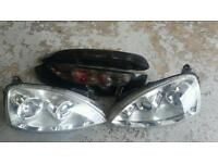 Corsa C facelift projector headlights and black tail lights good condition