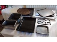 11 Assorted, used baking tins.