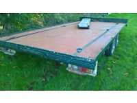 Car transporter trailer flatbed with 8 foot ramps and a winch