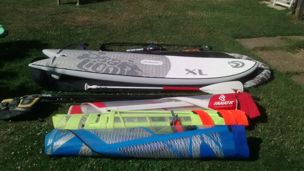 wind sup sealion hd xl with complete windsurf kitin Lancing, West SussexGumtree - The kit consists of Sealion hd xl (approx £850 new) with boardbag boom Prolimit pro 160 220 (approx £150 new) 3x sails scrambler 4.4m Fanatic Ride 5.5m2 Tushingham series 5sg 5m paddle (needs repair/replacement) mast extension and foot (approx £60...