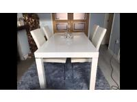 White high gloss dining table and 4 white leather look chairs