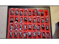 Warhammer - Mixture of space marine/orc and goblin characters+games workshop box in great condition.