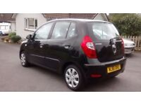 Hyundai i-10. Black, manual, petrol engine. Very low mileage and full service history.