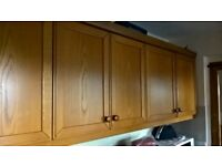 Solid oak kitchen cabinet doors and drawer fronts, 41 pieces.