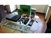 Xbox One 1TB with 2 controllers and games