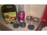 nutra bullet never been used but out of the box as had on display in my kitchen red in colour