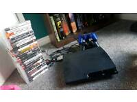 Ps3 with two pads and loads of games