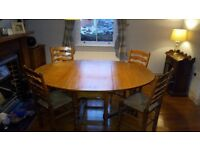 Solid oak dining table and 6 chairs.