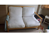 Ikea two seater wooden sofa in good condition
