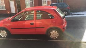 Red Vauxhall corsa 06 plate good condition