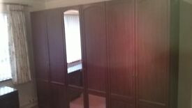 Bedroom furniture set in Dark wood