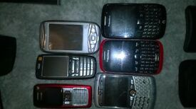 Selection of mobile phones with chargers, USB, car.