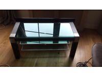 Black, glass and chrome TV unit