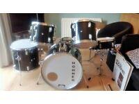Drum Kit plus drum mutes and sticks
